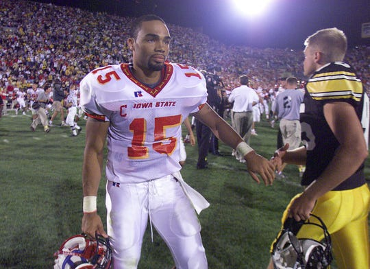 "Sept. 14, 2002: Iowa State quarterback Seneca Wallace, touching hands with Iowa kicker Nate Kaeding, completed a comeback against the Hawkeyes in 2002.  Wallace threw for a career-high 361 yards, then afterwards said: ""We knew we were capable of coming back."""