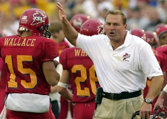 Sept. 28, 2002: Iowa State coach Dan McCarney celebrates with quarterback Seneca Wallace during the second quarter against Nebraska.