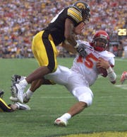 Sept. 14, 2002: Seneca Wallace scores Iowa State's second touchdown in front of Iowa's Kevin Worthy in the third quarter at Kinnick Stadium.