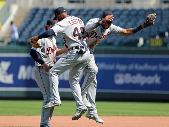 Tigers shortstop Willi Castro (49) and first baseman Jeimer Candelario celebrate after the Tigers' 6-4 win on Thursday, Sept. 5, 2019.