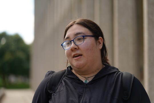 Wayne State University student Michelle Sladek, 24, talks on Sept. 4, 2019, about how she's playing an online trivia game called Givling, as a way to try to pay the bills and pay off about $60,000 in student loan debt.