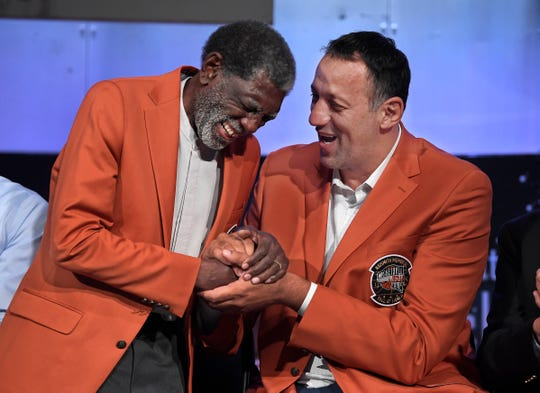 Class of 2019 inductees Al Attles, left, and Vlade Divac, right, laugh during a news conference at the Naismith Memorial Basketball Hall of Fame on Thursday.