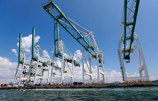 Large cranes to unload container ships are shown at PortMiami in Miami.