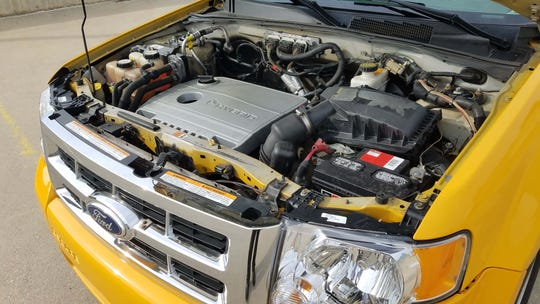 The 2012 Ford Escape Hybrid NYC Taxi mated a 2.5-liter gas engine to a nickel-metal hydride battery and electric motor.