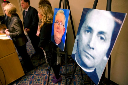 In this Nov. 13, 2013, file photo, a photo of Rev. Robert Brennan, right, is displayed during a news conference in Philadelphia, where attorneys for the family of Sean McIlmail, an alleged priest-abuse victim, announced a wrongful death lawsuit against Roman Catholic church officials. McIlmail claimed Brennan abused him for years, beginning at age 11. Federal prosecutors in Philadelphia have charged Brennan, a former Roman Catholic priest with lying to the FBI about whether he knew the accuser and his family. Authorities say Brennan was arrested in Maryland and is expected to be arraigned Thursday, Sept. 5, 2019, in Philadelphia.