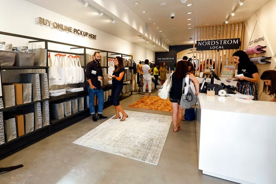 People visit the Nordstrom Local store, in New York's Upper East Side, Thursday, Sept. 5, 2019. The new store that Nordstrom opened carries no merchandise and instead offers tailoring services and allows customers to pick up or return online orders.