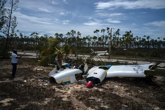 Destroyed planes sit on the side of a road in the Pine Bay neighborhood, in the aftermath of Hurricane Dorian, in Freeport, Bahamas, Wednesday, Sept. 4, 2019. Rescuers trying to reach drenched and stunned victims in the Bahamas fanned out across a blasted landscape of smashed and flooded homes Wednesday, while disaster relief organizations rushed to bring in food and medicine.