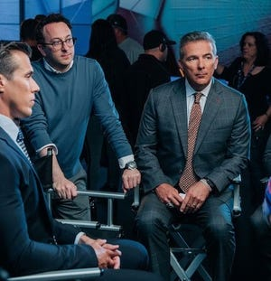 Brad Zager, middle, with Brady Quinn, left, and Urban Meyer on set.
