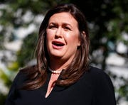 """In this June 11, 2019 file photo, White House press secretary Sarah Sanders talks with reporters outside the White House.  St. Martin's Press announced Thursday, Sept. 5,  that Sanders' memoir, currently untitled, will come out in the Fall 2020. Sanders will write about her time in the Trump administration, """"including the most dramatic and challenging moments,"""" and will also describe balancing an """"all-consuming job"""" with raising a family."""
