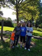 Krissi Kinney Pautansu and her son Renny, left, with their top fundraiser each year Jessica Decker Kubitski and her daughter, Cailey, who has a juvenile form of Huntington's.