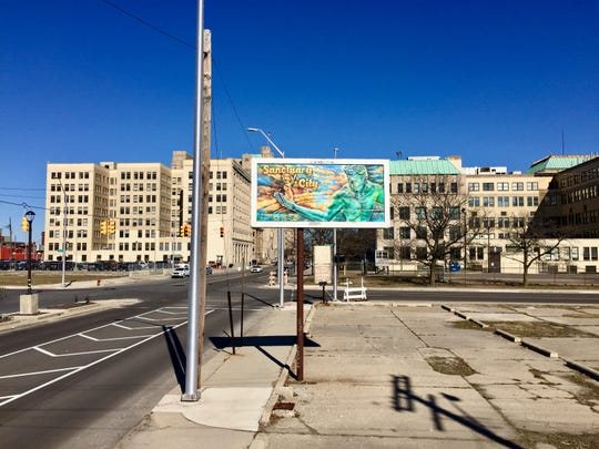 Four of Macdonald's works are on long-abandoned billboards throughout Detroit.