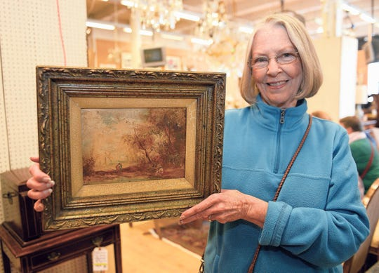"Wendy Berry of St. Clair Shores displays her ""Landscape"" oil painting by Van Ruiz."