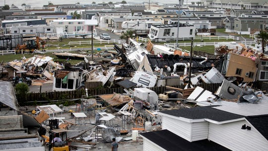 Mobile homes are upended and debris is strewn about at the Holiday Trav-l Park, Thursday, Sept. 5, 2019, in Emerald Isle, N.C, after a possible tornado generated by Hurricane Dorian struck the area.