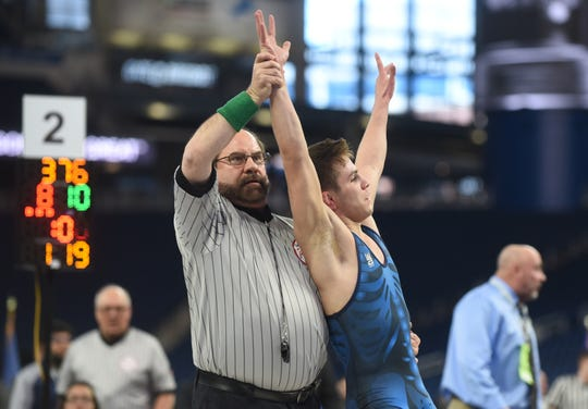 Wrestling for Niles High School, Austin Franco celebrates a victory in the state finals at Ford Field on May 3, 2018.