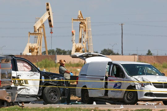 In this Sunday, Sept. 1, 2019, file photo, law enforcement officials process the crime scene from Saturday's shooting which ended with the shooter, Seth Ator, being shot dead by police in a stolen mail van, right, in Odessa, Texas. Within minutes of media outlets identifying the gunman who killed seven people in West Texas, a Twitter account was spreading false information linking the shooter to Democratic presidential candidate Beto O'Rourke. The speed of the misinformation again illustrates the eagerness of some to baselessly blame mass shootings on particular political ideologies.