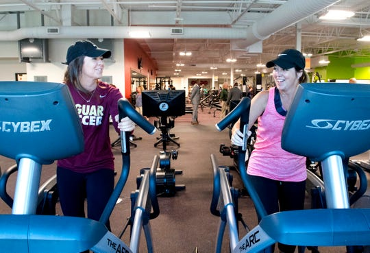 Carley Watters, left, and Susan Lombard, right, workout together in the new Ascension St. Vincent YMCA in Downtown Evansville during the grand opening Thursday evening, Sept. 5, 2019.