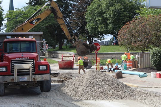 Work continued Thursday on the city's Garrison Street project, with contractors working at the intersection of Garrison and Arch Streets. Safety Service Director Kenneth Frost said that section of the project should be done by Sept. 30.