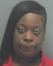 Shantell Thomas is charged with two counts of robbery with a firearm.