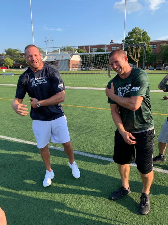 Retired NFL players Jordy Nelson and Brian Urlacher led members of the military in football drills Sept. 3 for a little friendly Green Bay Packers vs. Chicago Bears competition during USAA's Salute to Service NFL Boot Camp at Naval Station Great Lakes in North Chicago.