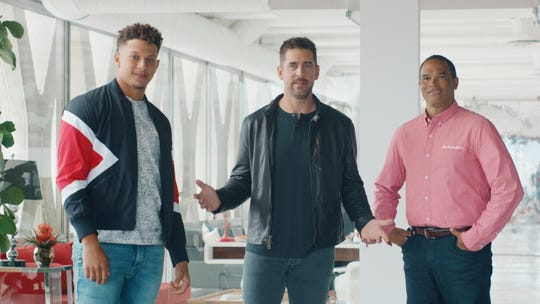 Kansas City Chiefs quarterback Patrick Mahomes, Green Bay Packers quarterback Aaron Rodgers and State Farm agent Patrick Minnis star in a new State Farm ad.