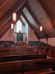 The sanctuary of the current New Jerusalem Missionary Baptist building still has a modern feel more than 30 years after it opened, even with refinished pews that are an estimated 70 years old.