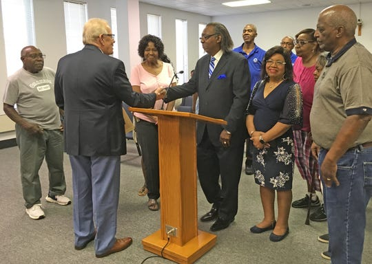 Henderson Mayor Steve Austin (second from left) shakes hands with Rev. Robert L. Whitlock (center), pastor of New Jerusalem Missionary Baptist Church, after reading a proclamation celebrating the 100th anniversary of the Fagan Street church during a Henderson City Commission meeting on Aug. 27, 2019.