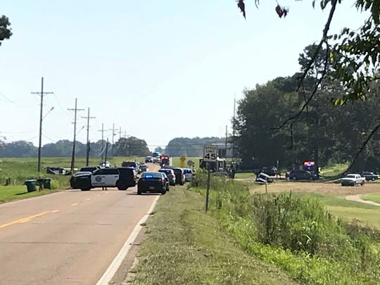 Law enforcement responds to the scene of a shooting in Canton, Miss., involving Madison County deputies on Thursday, Sept. 5, 2019.