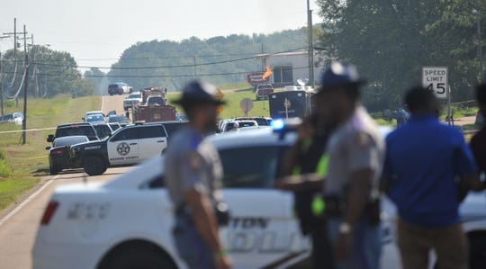 Multiple law enforcement agencies continue their investigation into the shooting of Madison County sheriff's deputies Thursday, Sept. 5, 2019, on Hwy. 16 along the edge of the Canton Country Club. Mississippi state troopers and Canton Police respond to the crime scene.