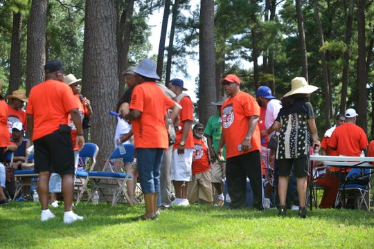 Former Lincoln Courts residents talk during the legacy reunion picnic Saturday at Forest Hill Park.