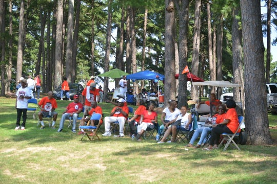 Former Lincoln Courts residents gather under the trees in Forest Hill Park during the legacy reunion picnic Friday.