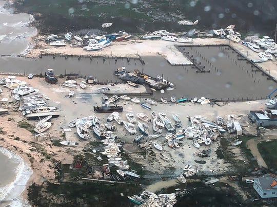 In this Monday, Sept. 2, 2019 photo released by the U.S. Coast Guard Station Clearwater, boats litter the area around marina in the Bahamas after they were tossed around by Hurricane Dorian. The storm pounded away at the islands in a watery onslaught that devastated thousands of homes, trapped people in attics and chased others from one shelter to another. At least five deaths were reported.