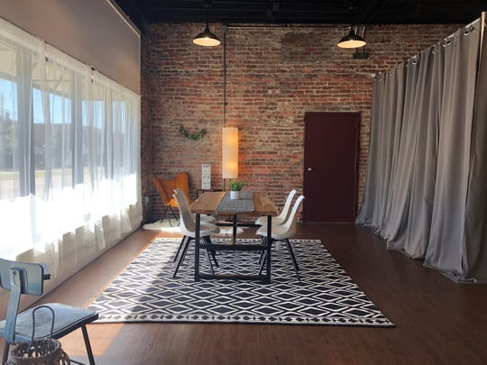 The new location for StudioWed Knoxville has been completely renovated, revealing lofty ceilings with exposed rafters and brick walls.