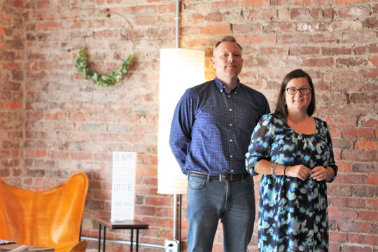 StudioWed Knoxville co-owners Brandi and Travis Woodall plan out their day in their new co-working space at 5435 North Broadway.