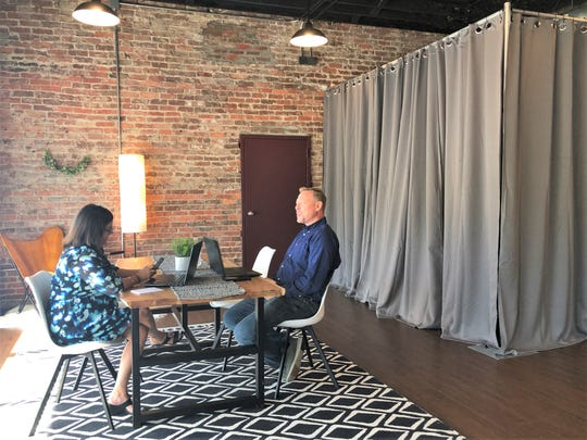 "StudioWed Knoxville co-owners, Brandi and Travis Woodall plan out their day in their new co-working space at 5435 North Broadway. ""We have found after 13 years in business that people like to refer people that they are genuinely comfortable with,"" said Travis Woodall, of the collaboration that occurs at StudioWed."