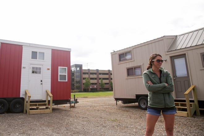 Maggie Daniels, founder of Try It Tiny, talks about at Hammer Down Town and set up of the eight tiny homes before the Purdue football home opener against Vanderbilt, Thursday, Sept. 5, 2019 in West Lafayette. The tiny home community from Try It Tiny, located at the corner of 3rd st. and McCutcheon drive, has eight homes available for booking for six home football games this season.