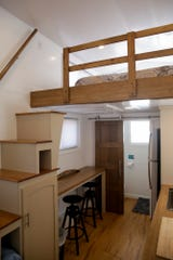 Inside one of the eight tiny homes at Hammer Down Town, Thursday, Sept. 5, 2019 in West Lafayette. The tiny home community from Try It Tiny, located at the corner of 3rd st. and McCutcheon drive, has eight homes available for booking for six home games this season.