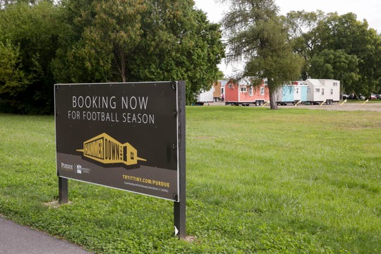 A sign advertises the eight tiny homes in Hammer Down Town, Thursday, Sept. 5, 2019 in West Lafayette. The tiny home community, located at the corner of 3rd st. and McCutcheon drive, has eight homes available for booking for six home games this season.