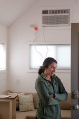 Maggie Daniels, founder of Try It Tiny, talks about at Hammer Down Town and set up inside one of the eight tiny homes before the Purdue football home opener against Vanderbilt, Thursday, Sept. 5, 2019 in West Lafayette. The tiny home community from Try It Tiny, located at the corner of 3rd st. and McCutcheon drive, has eight homes available for booking for six home football games this season.