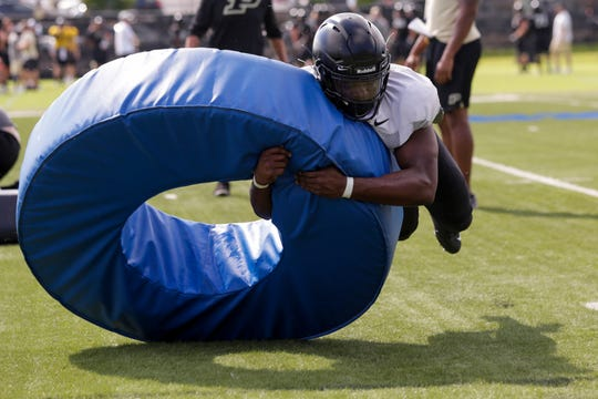Purdue linebacker Cornel Jones (46) tackles a ring during a practice, Wednesday, Sept. 4, 2019 at the Bimel Practice Complex in West Lafayette.