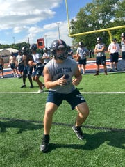 Senior Levi Casey works on blocking technique at practice on Wednesday.