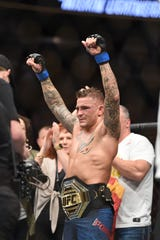 Dustin Poirier reacts after beating Max Holloway at UFC 236 to win the interim lightweight belt.