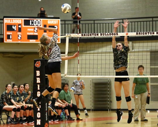Elaine Halonen (left) had nine kills for Brighton in a volleyball victory over Livonia Franklin.