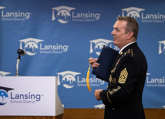 Command Sgt. Maj. (Ret) David Dunckel, 62, receives his high school diploma Thursday, Sept. 5, 2019, from the Lansing Board of Education. Dunckel is now an official member of Eastern High School's Class of 1975, 45 years after he dropped out to serve in the Navy.