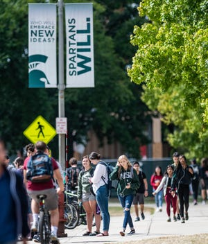 Students commute on the campus of Michigan State University Thursday, Sept. 5, 2019, near the International Center. Six months later, with the coronavirus arriving in the U.S., MSU made a rapid switch to online courses for most subjects.