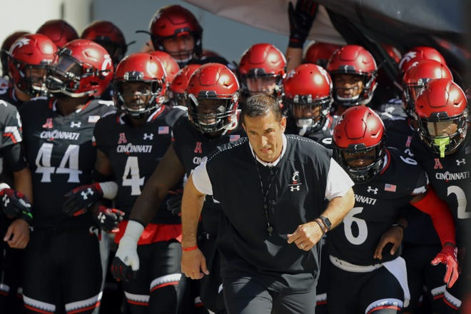 Former Ohio State nose tackle and linebackers coach Luke Fickell is coming home to lead his Cincinnati Bearcats against the No. 5 Buckeyes on Saturday.