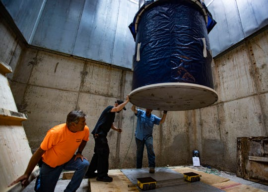Mike McGhee, from left, Bob Feldt and Bradley Bowman lower one of the world's most powerful magnets down into a 40-foot hole at the St. Jude NMR Spectroscopy Center on Sept. 5, 2019.
