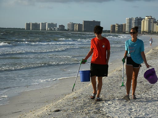 Volunteers scour South Beach during evening cleanup