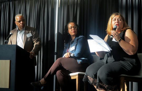 Scot Spencer, from left, Candice Rosales and Jessie Hendel discuss their study documenting links between housing stability and incarceration at the 2019 Affordable Housing Forum.