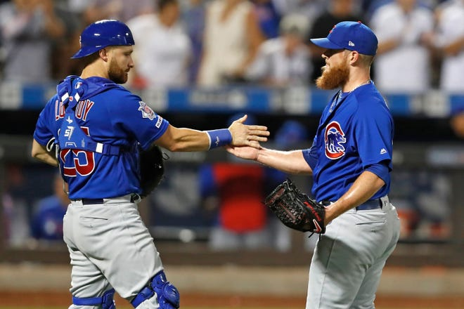 Cubs catcher Jonathan Lucroy, left, congratulates closer Craig Kimbrel after a victory over the Mets on Aug. 29.