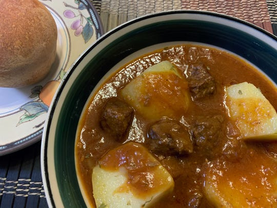 Horseradish Beef Stew is served over Yukon Gold potatoes.